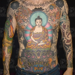 Tattoo Tibetan buddha and lotus by Darko groenhagen