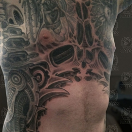 Tattoo Skulls biomechanical ribs by Darko groenhagen