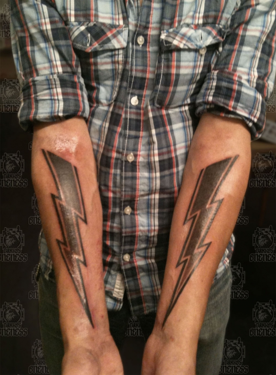 Skulls lightning arms darko oneness tattoo