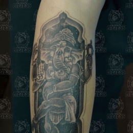 Tattoo Indonesian and indian arm ganesha by Darko groenhagen